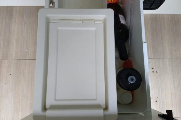 "This shows the IKEA trash bin in one of the galley drawers. It's just the right height to fit vertically and pairs with the other IKEA organizer ""thing"" to the right that holds bottles in this case and is just long enough to span the entire drawer depth."
