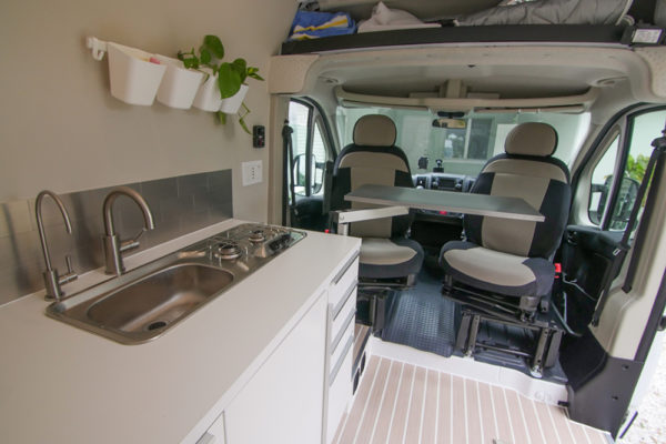 seats swiveled with table and galley